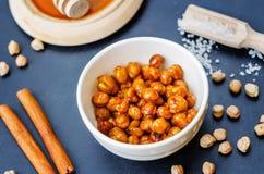 Roasted honey cinnamon chickpeas Stock Image