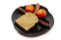 Roasted Hot Dogs with Toast and Red Tomatoes Royalty Free Stock Photos