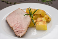 Roasted iberico pork meat with fried potatoes Stock Photos