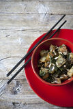 Roasted japanese turnips with leaves and seeds on red bowl Royalty Free Stock Images