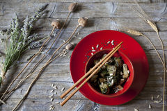 Roasted japanese turnips with leaves and seeds on red bowl Stock Image