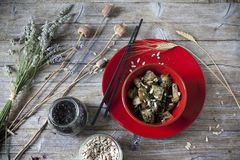 Roasted japanese turnips with leaves and seeds on red bowl Royalty Free Stock Photos