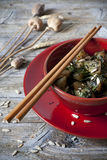 Roasted japanese turnips with leaves and seeds on red bowl Royalty Free Stock Image