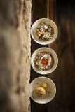Roasted jerusalem artichoke warm oyster choziro egg in three bow Royalty Free Stock Photo