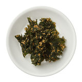 Roasted kale chips in a bowl isolated on white background Royalty Free Stock Photo
