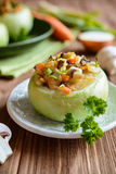 Roasted kohlrabi stuffed with mushrooms, onion and carrot Royalty Free Stock Photo