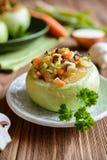 Roasted kohlrabi stuffed with mushrooms, onion and carrot. Vegetarian roasted kohlrabi stuffed with mushrooms, onion, eggs, and carrot Royalty Free Stock Photo
