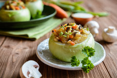 Roasted kohlrabi stuffed with mushrooms, onion and carrot Royalty Free Stock Photography