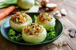 Roasted kohlrabi stuffed with mushrooms, onion and carrot Stock Image