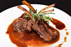 Roasted Lamb Chops. On Tomato Sauce royalty free stock images