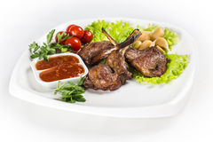 Roasted lamb chops with greens. On white plate Royalty Free Stock Images