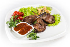 Roasted lamb chops with greens. On white plate Royalty Free Stock Photo