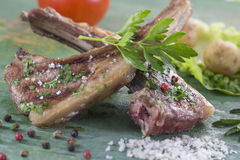 Roasted lamb chops with herbs and pepper stock photography