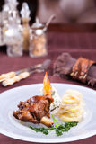 Roasted lamb chops with potato garnish. In a plate Stock Photo