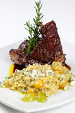 Roasted Lamb Chops with Risotto and Vegetables. stock image