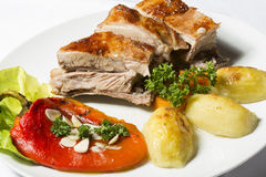 Roasted lamb with grilled red pepper and potato Stock Photo