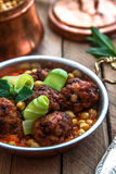 Roasted lamb kofte with tomato sauce in copper pan, close view Royalty Free Stock Photo