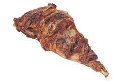 Roasted lamb leg. Closeup of roasted whole lamb leg with garlic isolated on white royalty free stock photo