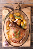 Roasted lamb leg. On board royalty free stock images