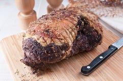 Roasted lamb leg seasoned with rosemary. And pepper stock photo