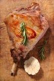 Roasted lamb leg. On wood stock images