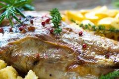 Roasted lamb leg. On wooden background stock image