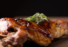 Roasted lamb leg. On wooden table stock images