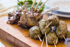 Roasted lamb meat on the big table Royalty Free Stock Images