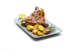 Roasted lamb with potatoes Royalty Free Stock Photos