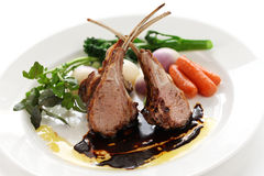 Roasted lamb rib chops. On a white background stock photo