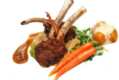 Roasted lamb rib chops with vegetables Stock Image