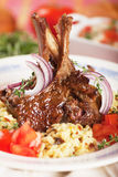Roasted lamb ribs. Roasted lamb chops with cooked rice, selective focus image Royalty Free Stock Image