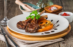 Roasted lamb ribs with  grilled pumpkin Royalty Free Stock Photos
