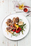 Roasted lamb ribs with grilled vegetables Stock Photo
