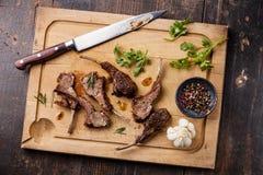 Roasted lamb ribs and kitchen knife Stock Photo