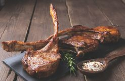 Roasted lamb ribs loin chop on a stone surface Stock Image
