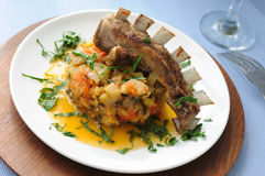 Roasted lamb ribs with stewed vegetables Stock Images