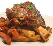 Roasted Lamb Shank. Lamb shank roasted with vegetables in gravy Stock Images