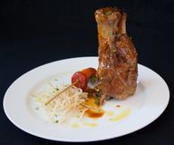 Roasted lamb shank stock photos