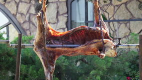 Roasted lamb on the spit stock video footage