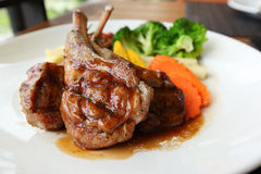 Roasted lamb with tomato sauce and fresh vegetables Stock Photos