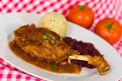 Roasted leg of duck, red cabbage and potato dumpli Stock Photo