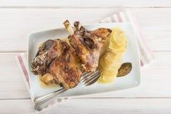 Roasted leg lamb with potatoes Stock Photo