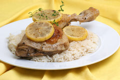 Roasted lemon chicken on some rice. Roasted lemon chicken on some organic rice stock photography