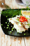 Roasted lemon sole on plate. Food close up Royalty Free Stock Images