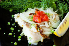 Roasted lemon sole with steamed vegetables Royalty Free Stock Photography