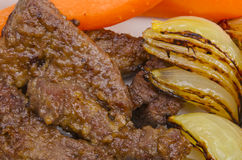 Roasted liver with vegetables Royalty Free Stock Photography