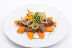 Roasted liver with vegetables Stock Image