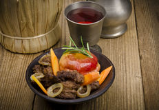 Roasted liver with vegetables Stock Photos
