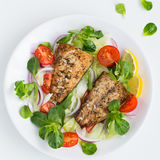 Roasted mackerel fish with fresh salad,. White background, top view, square image stock photos